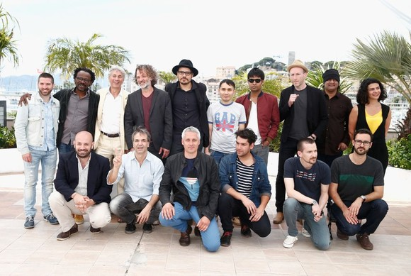 """CANNES, FRANCE - MAY 16:  (From top L) Director Guy Edoin, director Newton Ifeanyi Aduaka, The President of the Altelier Georges Goldenstern, director Bassam Chekhes, director Daniel Castro Zimbron, director Adilkhan Eejanov, director Deepak Rauniyar, director Mikhael Hers, director K. Rajagopal and director Nora Martirosyan, (bottom from L) director Antonio Mendez Esparza, director Pablo Giorgelli, director Marc Recha, director Matias Rojas Valencia, director Bogdan Mirica and director Igor Drljaca attend the """"L'Atelier"""" Photocall during the 67th Annual Cannes Film Festival on May 16, 2014 in Cannes, France.  (Photo by Andreas Rentz/Getty Images)"""